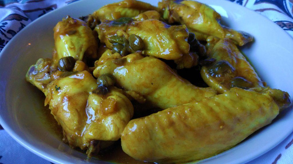 Alette di pollo saporite in salsa